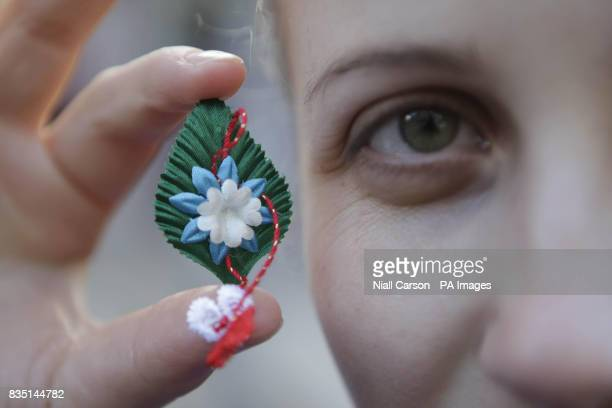 Olesea Stamati a volunteer from the Association of the Moldovan Community in Ireland hands out flowers in the Temple Bar Dublin to mark the arrival...