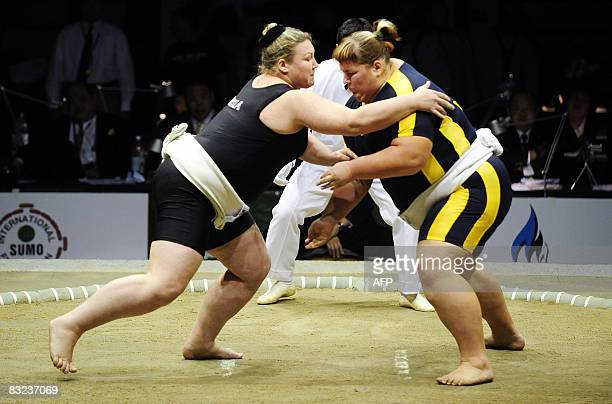 Olesya Kovalenko of Russia vies with Olga Davydko of Ukraine in their women's heavyweight division match during the 16th Sumo World Championships on...