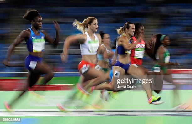 Olesya Povkh of Ukraine and Ewa Swoboda of Poland compete in the Women's 100m Round 1 on Day 7 of the Rio 2016 Olympic Games at the Olympic Stadium...