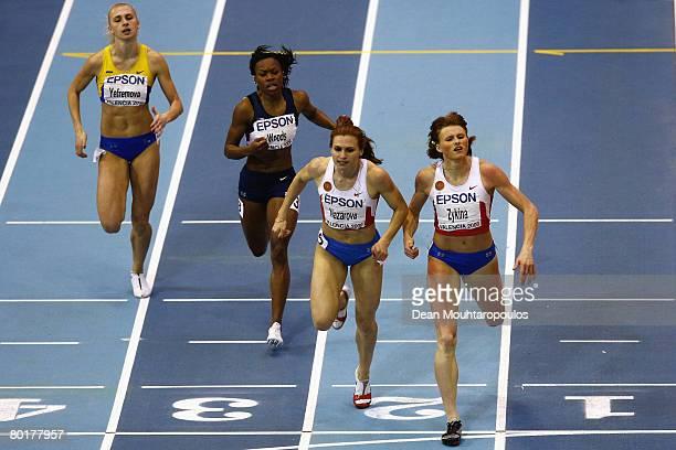 Olesya Zykina of Russia Natalya Nazarova of Russia Shareese Woods of USA and Antonina Yefremova of Ukraine cross the line in the Womens 400 metres...