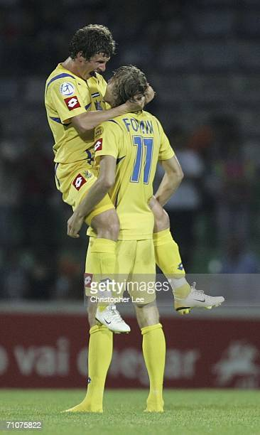 Olexandr Aliyev of Ukraine is lifted in the air by his team mate Ruslan Fomin after their victory in the UEFA U21's Championship 2006 match between...