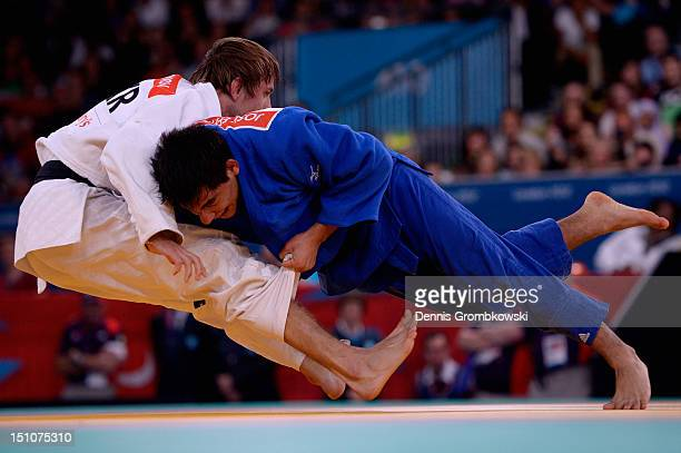 Olexandr Kosinov of Ukraine and Jose Effron of Argentina compete in the Men's 81kg Gold Medal Contest on day 2 of the London 2012 Paralympic Games at...