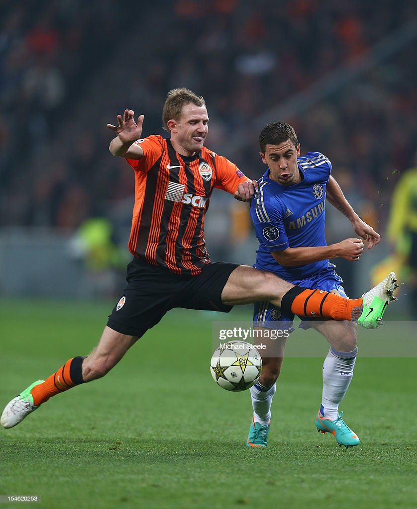Olexandr Kucher (L) of Shakhtar Donetsk fouls Eden Hazard (R) of Chelsea during the UEFA Champions League Group E match between Shakhtar Donetsk and Chelsea at the Donbass Arena on October 23, 2012 in Donetsk, Ukraine.
