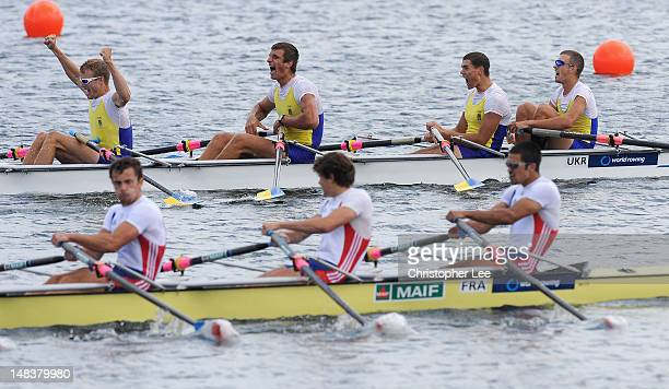 Olexandr Nadtoka Anton Bondarenko Artem Verestiuk and Andril Mykhailov of Ukraine celebrate winning the Men's Quadruple Sculls Final during Day 5 of...