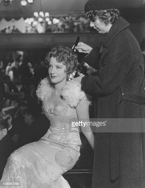 Olga a hairdresser arranges actress Jeanette MacDonald's coiffure before a scene in the MGM film 'San Francisco' 1936