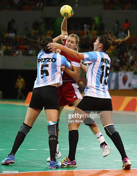 Olga Akopian of Russia is challenged by Manuela Pizzo of Argentina and Antonela Mena of Argentina during the Womens Preliminary Group B match between...