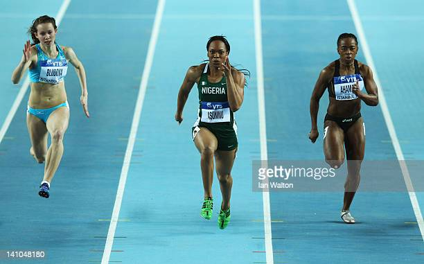 Olga Bludova of Kazakhstan Gloria Asumnu of Nigeria and Feta Ahamada of the Comoros Islands compete in the Women's 60 Metres first round during day...