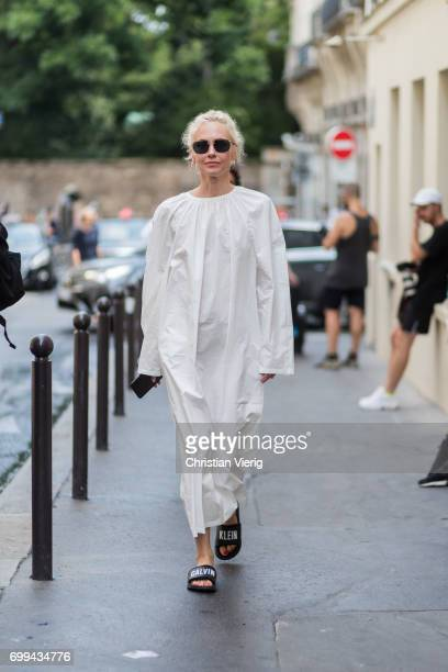 Olga Carput wearing a creme maxi dress with long sleeves Calvin Klein bath shoes outside Lemaire during Paris Fashion Week Menswear Spring/Summer...
