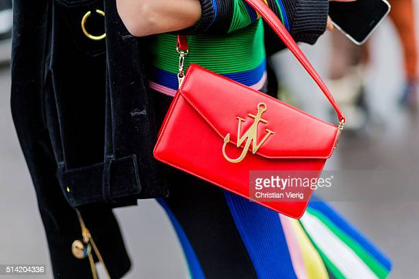 Olga Carput wearing a multi color striped jumper and skirt and a red JW Anderson bag outside Stella McCartney during the Paris Fashion Week...