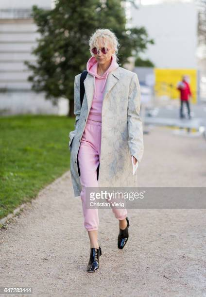 Olga Carput wearing a pink hoody and jogger pants outside Chloe on March 2 2017 in Paris France