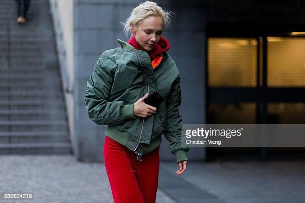 Olga Carput wearing red velvet pants bomber jacket outside Vetements on January 24 2017 in Paris Canada
