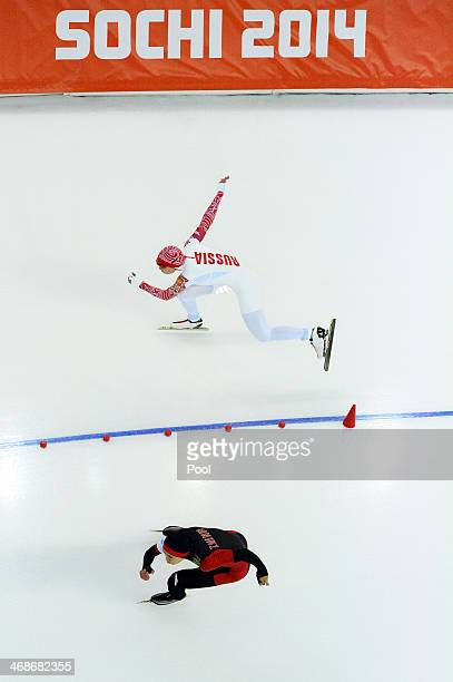 Olga Fatkulina of Russia and Beixing Wang of China compete during the Women's 500m Speed Skating event during day 3 of the Sochi 2014 Winter Olympics...