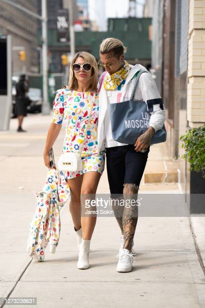 Olga Ferrara and Chris Lavish wear head to toe looks by Moschino on September 17, 2020 in New York City.
