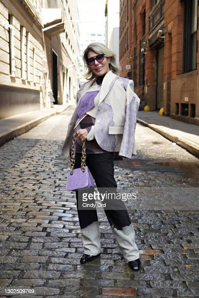 Olga Ferrara poses for a photo during New York Fashion Week: The Shows at Spring Studios on February 16, 2021 in New York City.