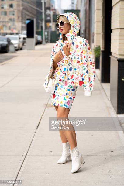 Olga Ferrara wears a head to toe look by Moschino on September 17, 2020 in New York City.