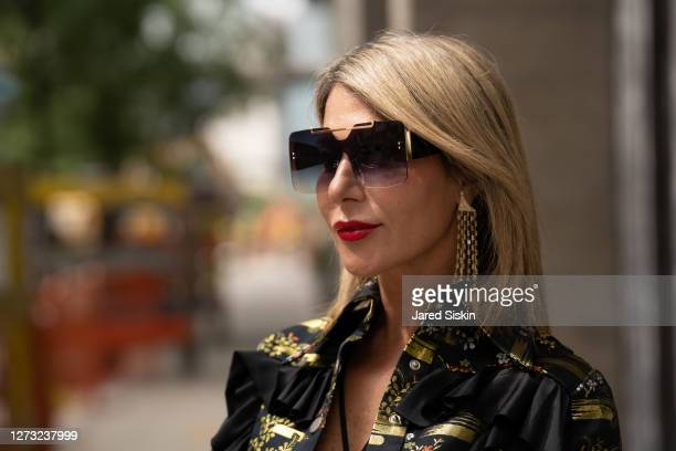 Olga Ferrara wears Callista by Vinta earrings and a black and gold Videmus Omnia Jacket on September 17, 2020 in New York City.