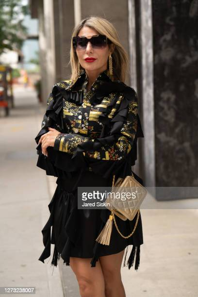Olga Ferrara wears Callista by Vinta earrings, black and gold Videmus Omnia Jacket, black skirt and a St. Jonhs bag on September 17, 2020 in New York...