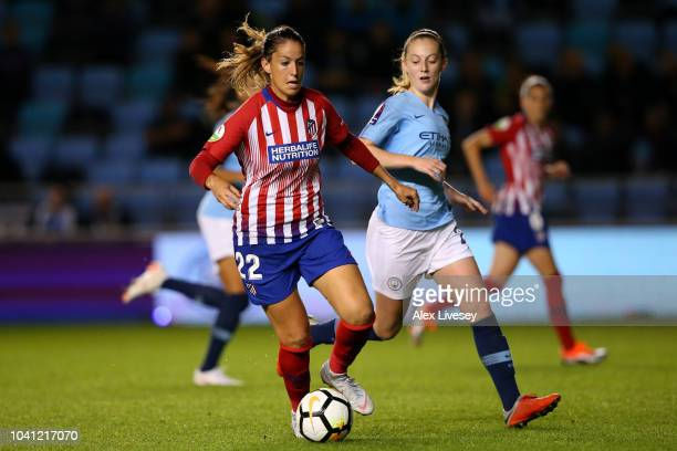 Olga Garcia of Atletico de Madrid controls the ball as Keira Walsh of Manchester City Women looks on during the Womens UEFA Champions League 2nd Leg...