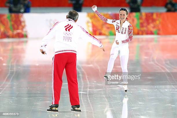 Olga Graf of Russia jubilates with her coach during the Women's 3000m Speed Skating event during day 2 of the Sochi 2014 Winter Olympics at Adler...