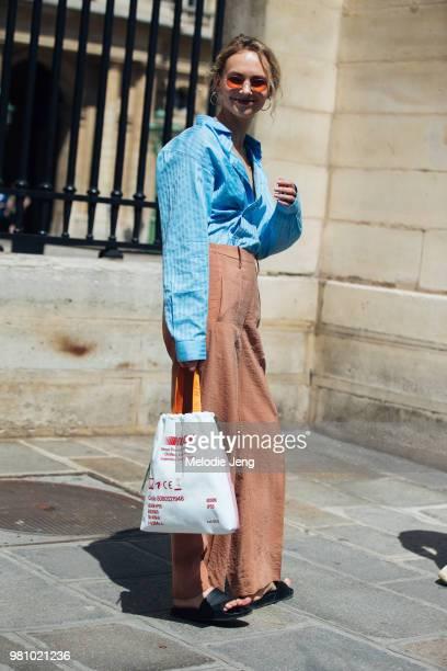 Olga Karput carries a Heron Preston bag during Paris Fashion Week Mens Spring/Summer 2019 on June 21 2018 in Paris France