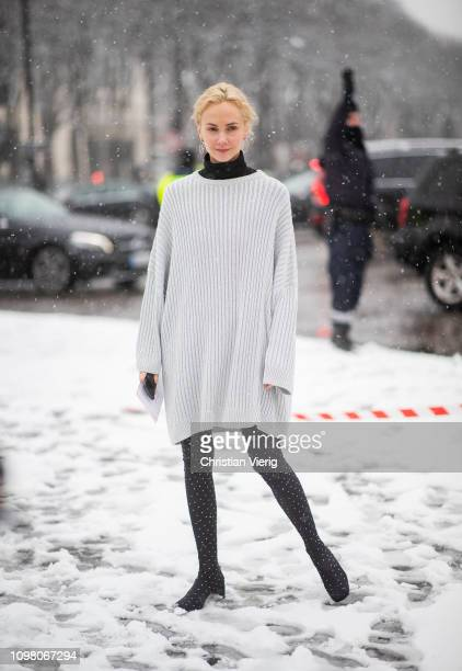 Olga Karput is seen wearing white oversized knit outside Chanel during Haute Couture Spring Summer 2019 Day Two on January 22 2019 in Paris France