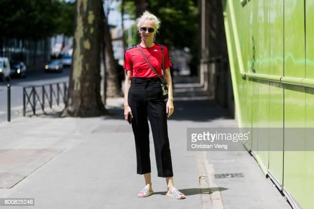 Olga Karput wearing black high waisted pants red tshirt outside Y3 during Paris Fashion Week Menswear Spring/Summer 2018 Day Five on June 25 2017 in...