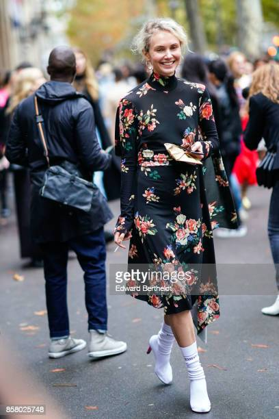 Olga Karput wears a floral print silk dress white shoes outside Valentino during Paris Fashion Week Womenswear Spring/Summer 2018 on October 1 2017...