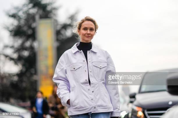 Olga Karput wears a turtleneck and a white jacket during Paris Fashion Week Womenswear Fall/Winter 2018/2019 on March 1 2018 in Paris France