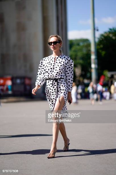 Olga Karput wears a white dress with black prints sunglasses outside OffWhite during Paris Fashion Week Menswear SpringSummer 2019 on June 20 2018 in...