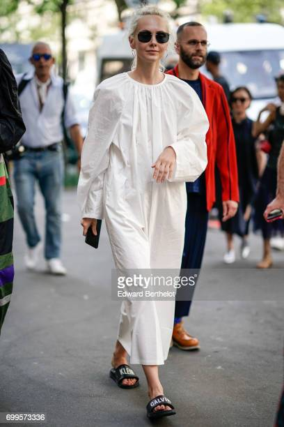 Olga Karput wears a white full outfit outside the Y/Project show during Paris Fashion Week Menswear Spring/Summer 2018 on June 21 2017 in Paris France