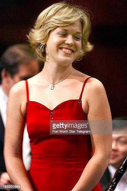 Olga Kern accepts the standing ovation after she finished performing in the Eleventh Van Cliburn International Piano Competition at Bass Hall June 9...