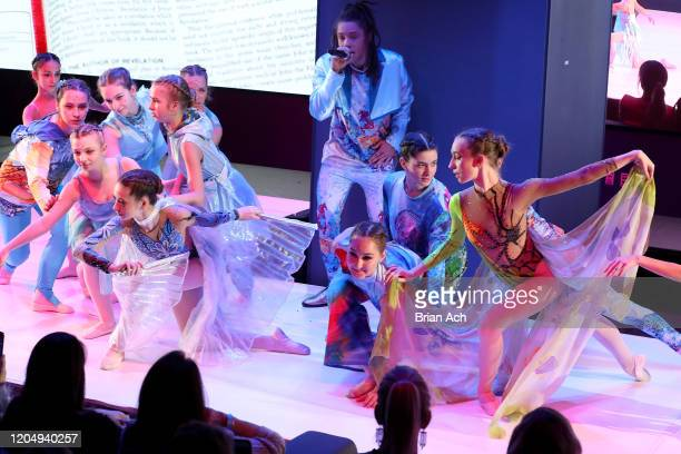 Olga Krespin dance company and Ju-lyon Grant perform onstage wearing dkDesign Fashion during NYFW Powered By hiTechMODA on February 08, 2020 in New...