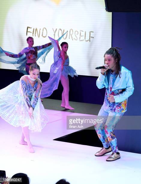 Olga Krespin dance company and Ju-lyon Grant performs original music and video onstage wearing dkDesign Fashion during NYFW Powered By hiTechMODA on...