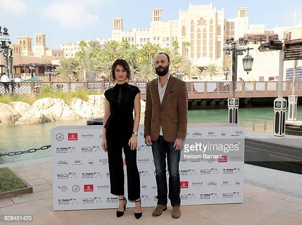 Olga Kurylenko and Ali Suliman attend the IWC Filmmaker Award photocall during day two of the 13th annual Dubai International Film Festival held at...