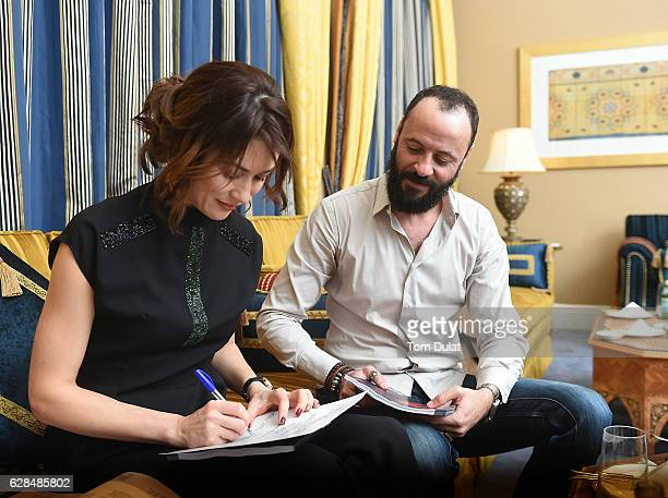 Olga Kurylenko and Ali Suliman attend the jury meeting of the fifth IWC Filmmaker Award at the 13th Dubai International Film Festival during which...