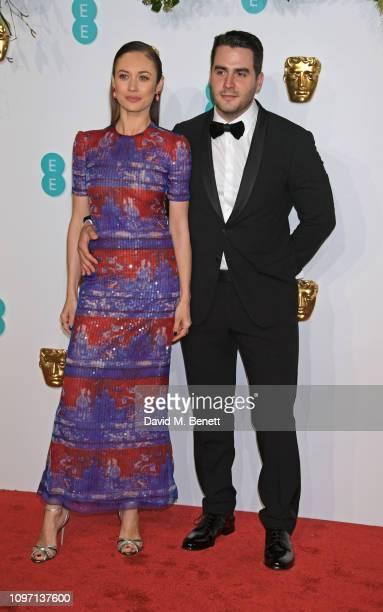 Olga Kurylenko and Ben Cura attend the EE British Academy Film Awards at Royal Albert Hall on February 10 2019 in London England