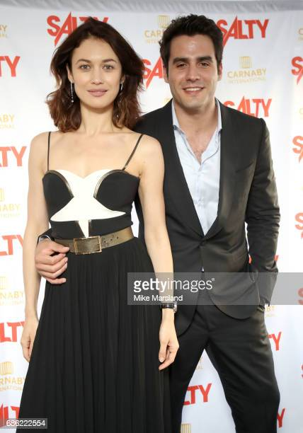 Olga Kurylenko and Ben Cura attend the Fashion for Salty afterparty during the 70th annual Cannes Film Festival at on May 20 2017 in Cannes France