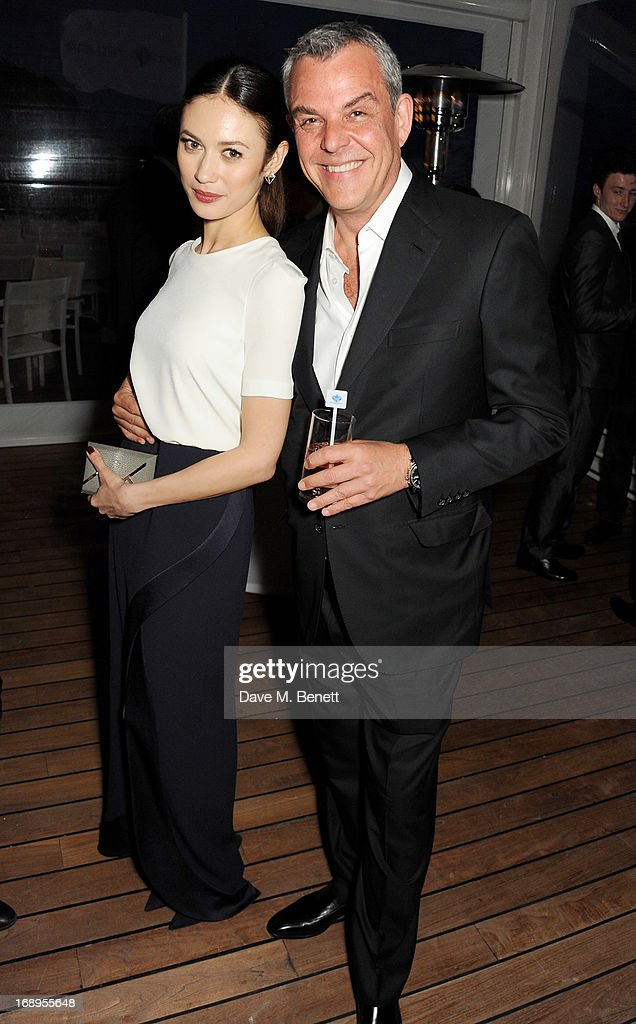 Olga Kurylenko (L) and Danny Huston attend the annual Finch's Quarterly Review Filmmakers Dinner hosted by Charles Finch, Caroline Scheufele and Nick Foulkes at Hotel Du Cap Eden Roc on May 17, 2013 in Antibes, France.