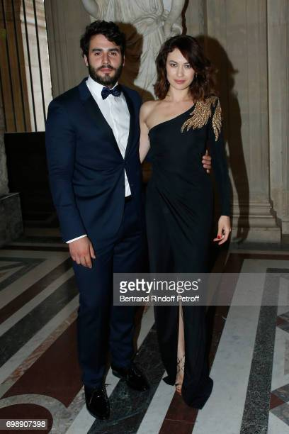 Olga Kurylenko and her companion Ben Cura attend the Liaisons au Louvre IV Evening of patronage for the benefit of the Louvre Museum at Musee du...