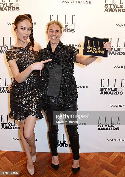 Olga Kurylenko and Isabel Marant, winner of Contemporary Designer of the Year, pose in the winners room at the Elle Style Awards 2014 at One...