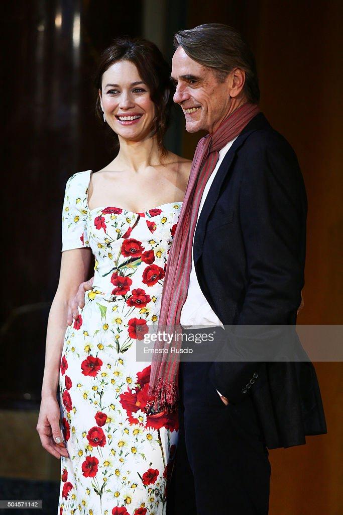 Olga Kurylenko and Jeremy Irons attend the 'La Corrispondenza' photocall at Hotel St Regis on January 11, 2016 in Rome, Italy.