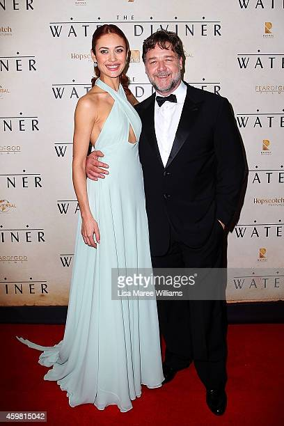 Olga Kurylenko and Russell Crowe arrive at the World Premier of 'The Water Diviner' at the State Theatre on December 2 2014 in Sydney Australia