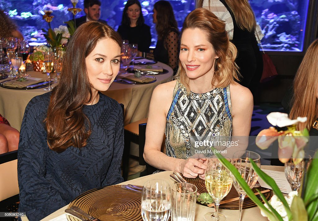 Olga Kurylenko (L) and Sienna Guillory attend a private dinner hosted by Creme de la Mer to celebrate the launch of Genaissance de la Mer the Serum Essence, available exclusively at Harrods, at Sexy Fish on January 21, 2016 in London, England.