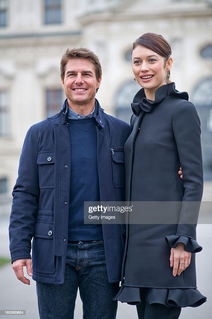 Olga Kurylenko and Tom Cruise attend a photo call for the film 'Oblivion' at Belvedere Palace on April 2, 2013 in Vienna, Austria.
