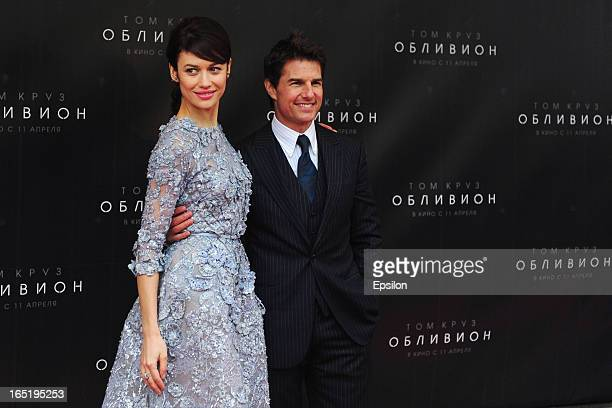 Olga Kurylenko and Tom Cruise attend the film premiere of 'Oblivion' at the Oktyabr cinema hall on April 1 2013 in Moscow Russia