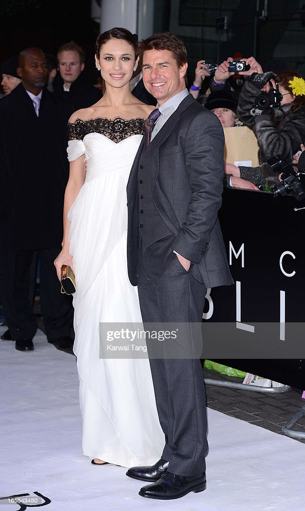 Olga Kurylenko and Tom Cruise attends the UK premiere of 'Oblivion' at BFI IMAX on April 4, 2013 in London, England.
