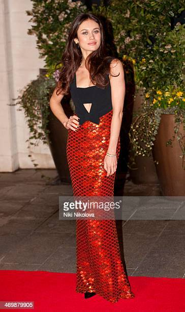 Olga Kurylenko arrives at the Bafta after party held at the Grosvenor Hotel Park Lane on February 16 2014 in London England