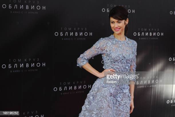 Olga Kurylenko attend the film premiere of 'Oblivion' at the Oktyabr cinema hall on April 1 2013 in Moscow Russia