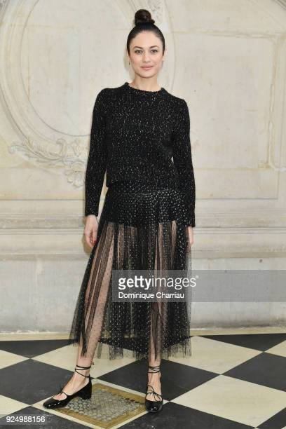 Olga Kurylenko attends the Christian Dior show as part of the Paris Fashion Week Womenswear Fall/Winter 2018/2019 on February 27 2018 in Paris France