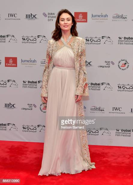 Olga Kurylenko attends 'The Death of Stalin' red carpet on day three of the 14th annual Dubai International Film Festival held at the Madinat...